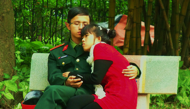 Two young lovers outside Ho Chi Minh's Mausoleum in Hanoi.